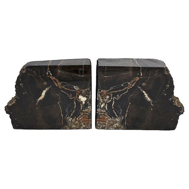 Large petrified wood bookends with crystal detail. Polished fronts, felted sides, and natural edges and backs. No maker's...