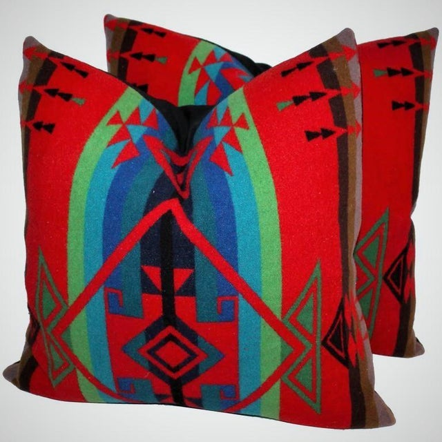 These amazing Pendleton Indian patterned camp blanket pillows are in pristine condition. The backing is in black cotton...
