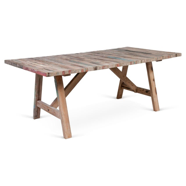 A trestle table made from a salvaged fishing boat in Bali. A unique piece to add to your room. Overtime, it will gain a...