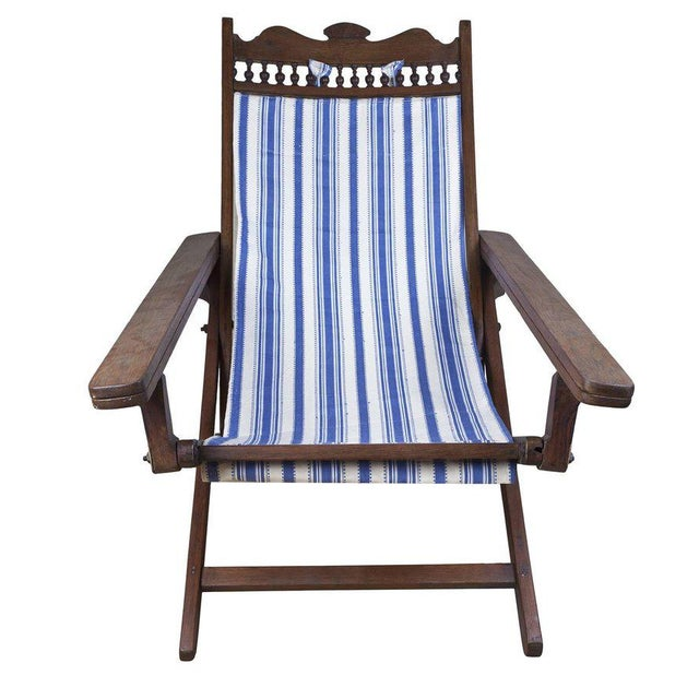 British Campaign sling-back teak plantation chair from the 1940s (fabric replaced). It folds, adjusts (4 settings) and the...