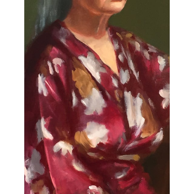 This is an original oil portrait of a woman in red robe sitting on the chair. I painted it from life in The Art Students...
