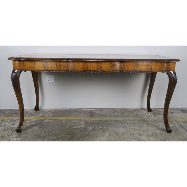 French inlaid walnut veneered writing table standing on four cabriole legs. From underneath it looks as though it...