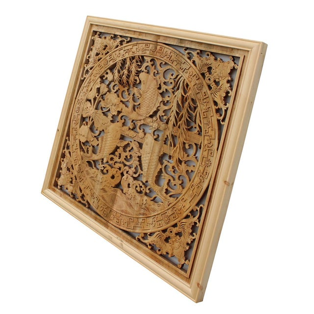This is a square wooden wall decor with Chinese flower and fishes theme surrounded by simple geometric pattern. (...