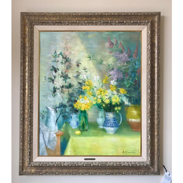 "Magnificent oil painting of flowers titled ""L'ombre Portee"" by listed artist Andre Vignoles. Displayed in a carved wood..."