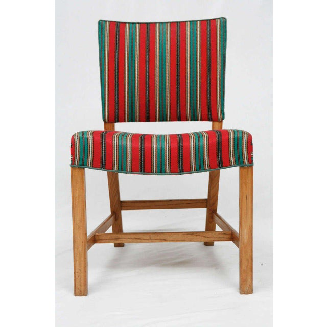 Set Of 8 Kaare Klint dining chairs in elm wood. Designed In 1927 and produced by Rud Rasmussen. Store formerly known as...