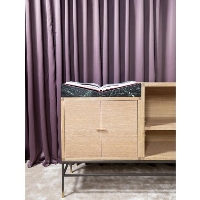 The Landscape Credenza is a showcase for your most treasured books and objects. A sculpted block of marble cradles and...