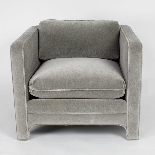 A pair of large-scale fully upholstered club chairs by Chicago manufacturer Interior Crafts. The simple cube design is...