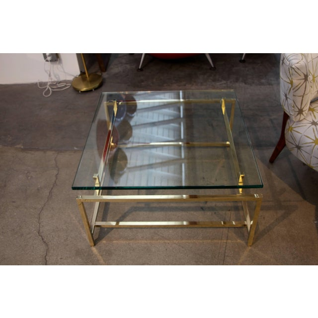 A vintage brass cocktail table. Well constructed with parts that screw together.