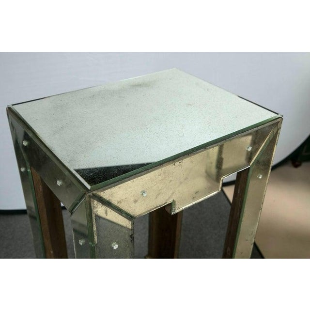 Antiqued mirrored side or end table. An intriguing Art Deco inspired lamp / end table. Solid wood case having antiqued...