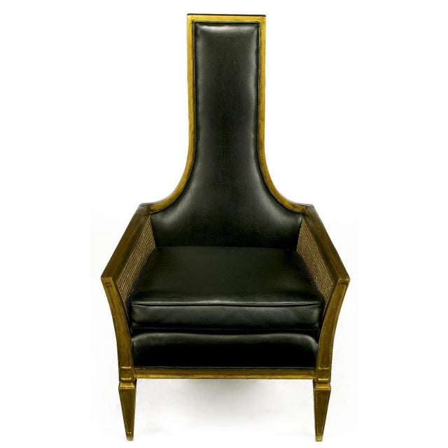Moorish style tall back lounge chair with an ebony glazed gold lacquer frame and cane sides. Upholstered in high quality...
