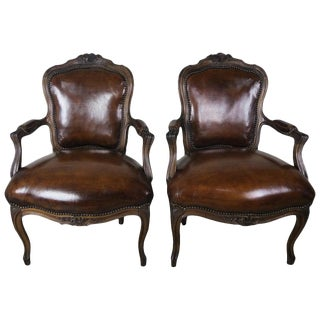 Pair of French Carved Leather Upholstered Armchairs For Sale