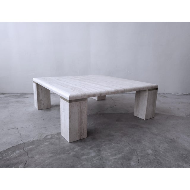 Very elegant, vintage square travertine coffee table. Simple, beautiful piece. Tabletop is a square with 4 large square...