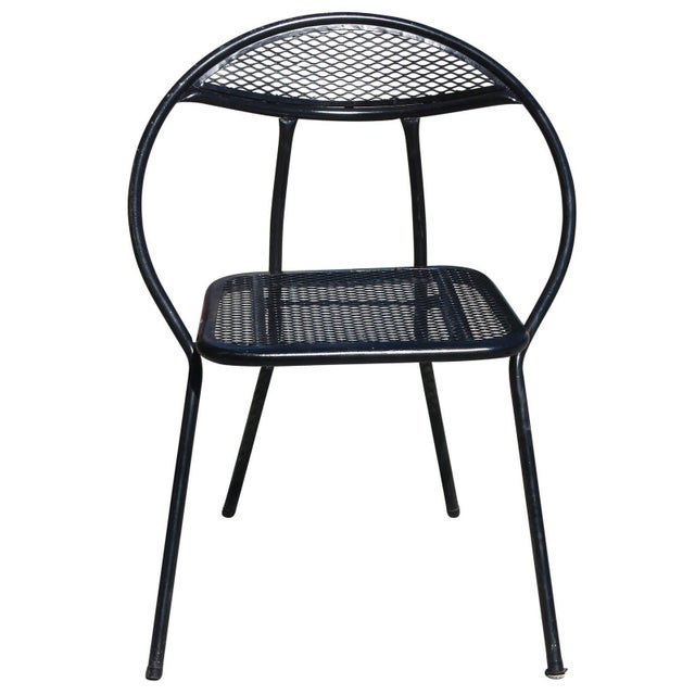 This Mid-Century Modern outdoor dining set by Salterini features four rounded-back, folding chairs and a square dining...
