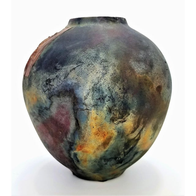 Offering a vintage 1970s Raku studio art pottery vase with a large scarab beetle on the front. The vase is most likely...