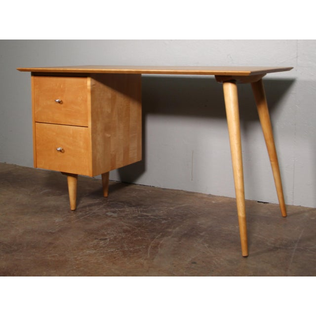 1960's Paul McCobb desk. Solid maple and fully restored. Original handles. Excellent vintage condition.