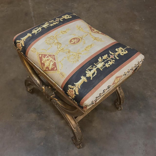 19th Century Giltwood Vanity Stool features a design that dates back to ancient Greece, and the original gilt finish...