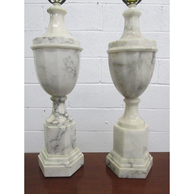 """Sunning pair of Italian marble urn lamps with nice grains. One is slightly taller. Taller measures: 33.5""""H; to top of..."""