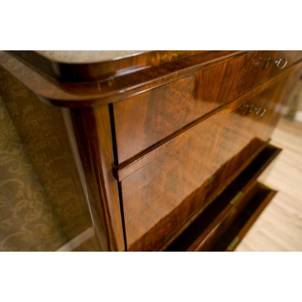 This piece of furniture of a simple shape was manufactured in Scandinavia.The secretary desk has rounded corners and...