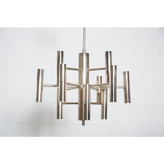 Chrome and brushed steel multi armed chandelier. Some irregularities, in original condition with visible signs of wear....