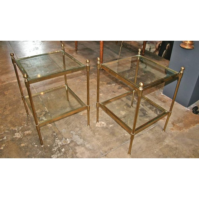Pair of Italian 1960s two-tier end tables in brass and glass.