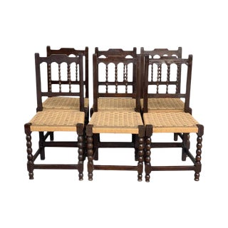 20th Century Set of Six Catalan Chairs in Carved Walnut and Caned Seats For Sale