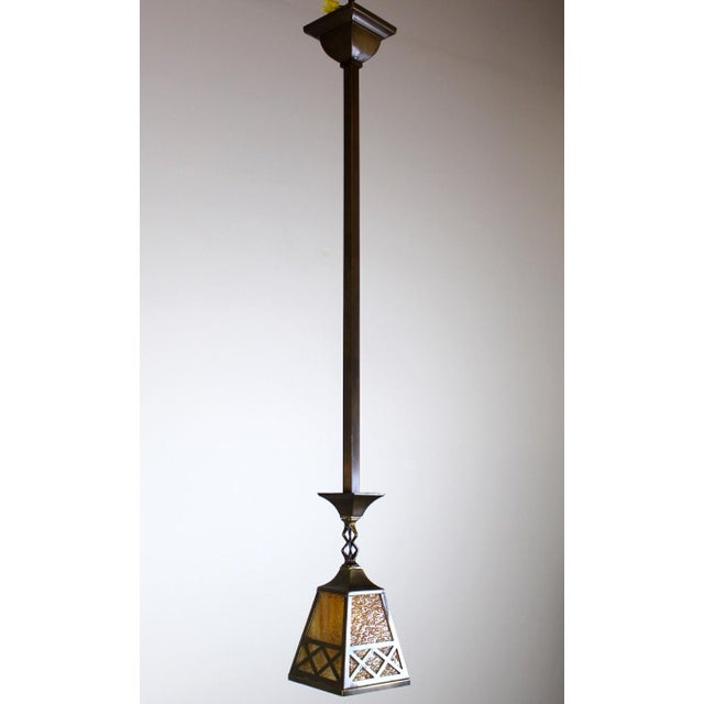 Arts & Crafts Style Pendant Fixture. Original shades with unusual criss-cross design. Finished in a chocolate bronze...