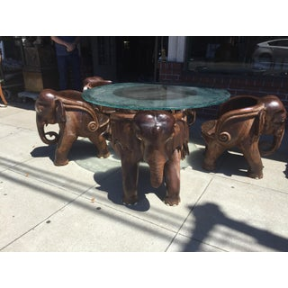 Carved Elephant Table and Four Chairs Preview