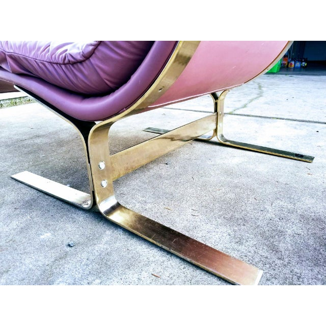 This is a gorgeous mauve leather and brass plated steel frame lounge chair and ottoman by Lane, in the iconic style of...