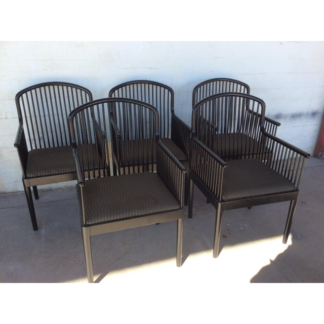 Set of 5 arm chairs made in Italy by Stendig. Great spindle design lacquered black. Nice flowing sculptural line starting...