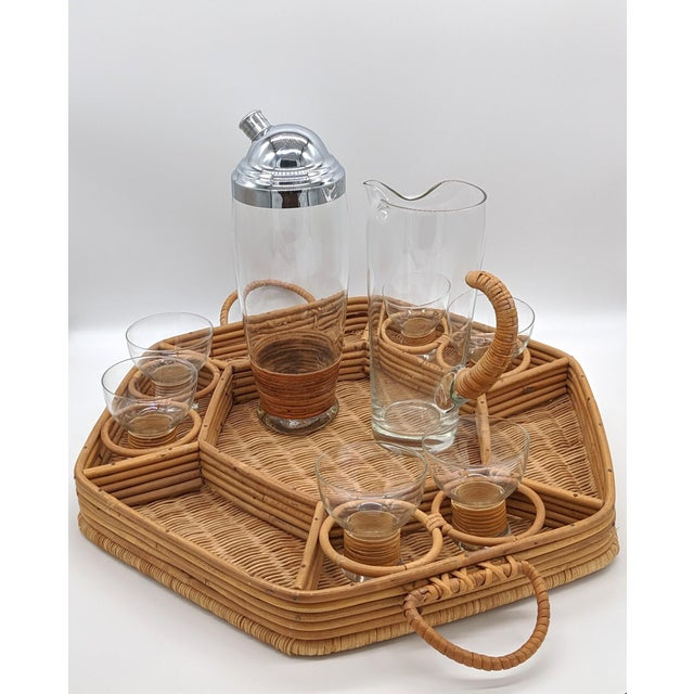 Charming, mid-century bar service with a cocktail shaker, pitcher and 8 glasses. Each piece is made of transparent glass...