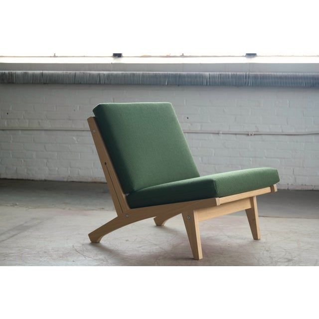 Sublime easy chair designed by Hans Wegner in 1969 and manufactured by GETAMA. This model is in soap treated oak with...