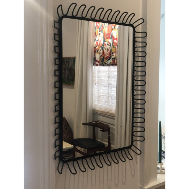 Mirror with ringed metal frame made in France in the 1950's.