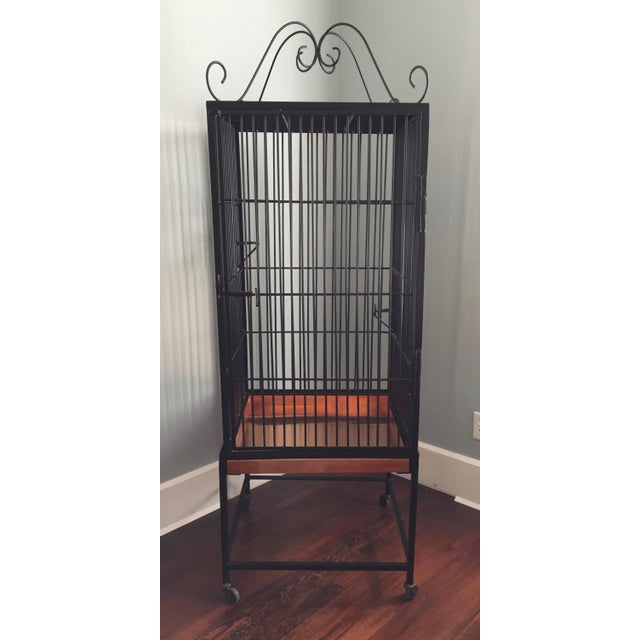 Large, vintage wrought iron birdcage for display or storage, or a garden accent. We can envision some salvage wood shelves...