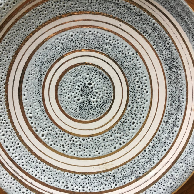 A very cool mid century modern decorative plate that could be displayed on a table, stand, or the wall.