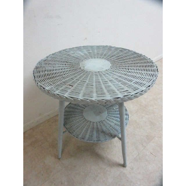 An antique Victorian wicker patio table. Great shape. tight and sturdy.. Minor scratches and rub marks. some flaking...