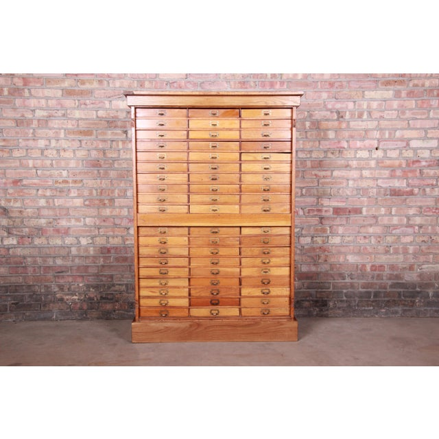 """A rare antique oak multi-drawer cabinet Stamped """"Property of the Board of Education Grand Rapids"""" USA, Circa 1920s Solid..."""