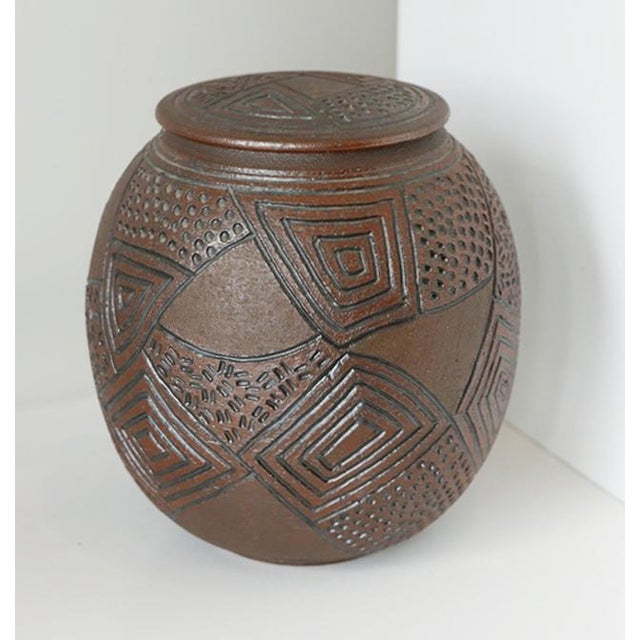 J Chin 1989 incised pottery jar. Incising is engraving a design by cutting or scraping into the clay surface. It is useful...