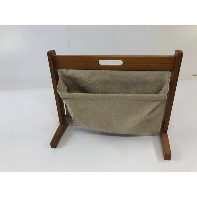 Vintage Magazine Rack. Teak construction with neutral canvas pockets. Excellent condition. On tiny nick on top handle...