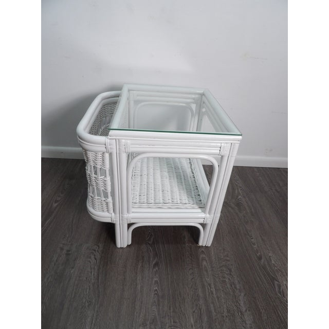 Unique glass topped wicker side table with side magazine pocket. This striking side table has been professionally...