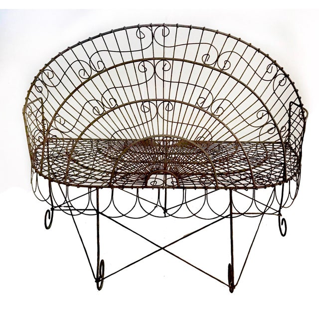 This beautiful, French wire garden bench dates from the turn of the century. Made from iron, it's incredibly sturdy and...