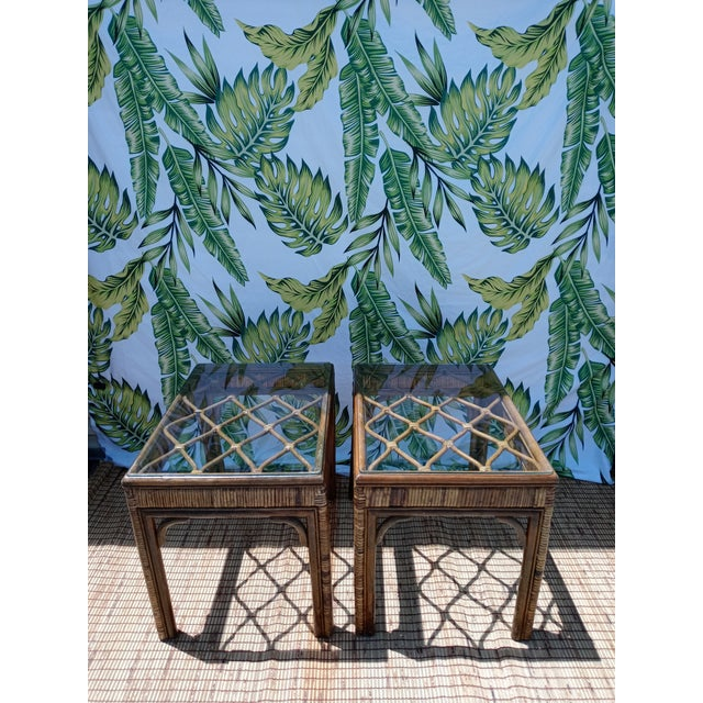A pair of rattan stained diamond top side end tables. The tables have such a pretty design with glass on top. They're nice...