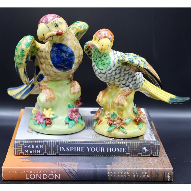 A superb pair of mid-20th century parrots carrying cherry stems in their beaks. Vivid colors, large size, ornate design....