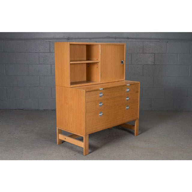 Oak bookcase unit and chest with stainless steel handles. A beautiful Mid-Century piece with plenty of storage space!