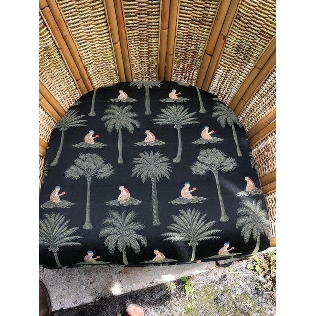 1970s Vintage Rattan Palm Frond Chairs With Unused Monkey Embroidered Upholstery ( White Reflections on Fabric Is Camera) Green at Feet Is Grass - a Pair For Sale - Image 5 of 7