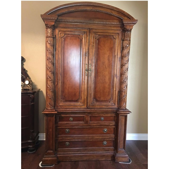 Hekman Armoire, two pieces, very heavy. Top section may be used to hold a TV or set up the additional shelving for storage...