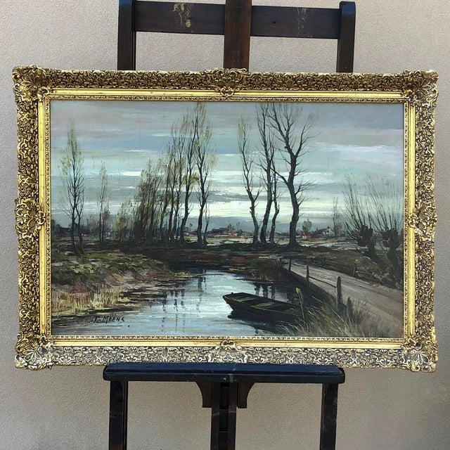 Antique Framed Oil Painting on Canvas signed T. Moens is a late winter scene, with the trees in the depiction just...