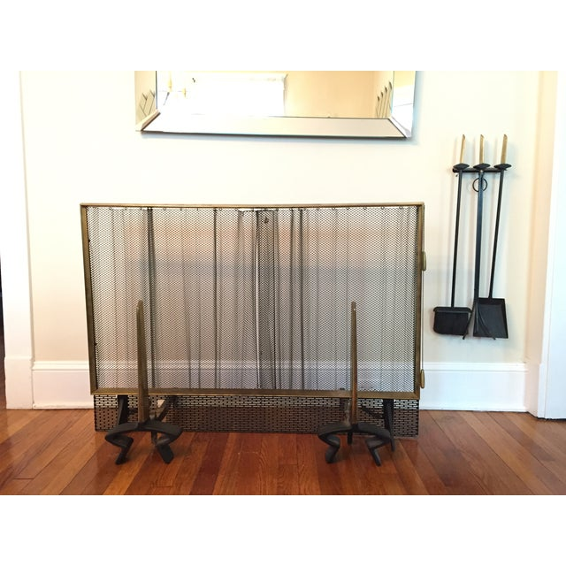 Black iron and polished brass set. Includes fire screen, andirons, fire tools and RARE wall mount. Andirons are signed...