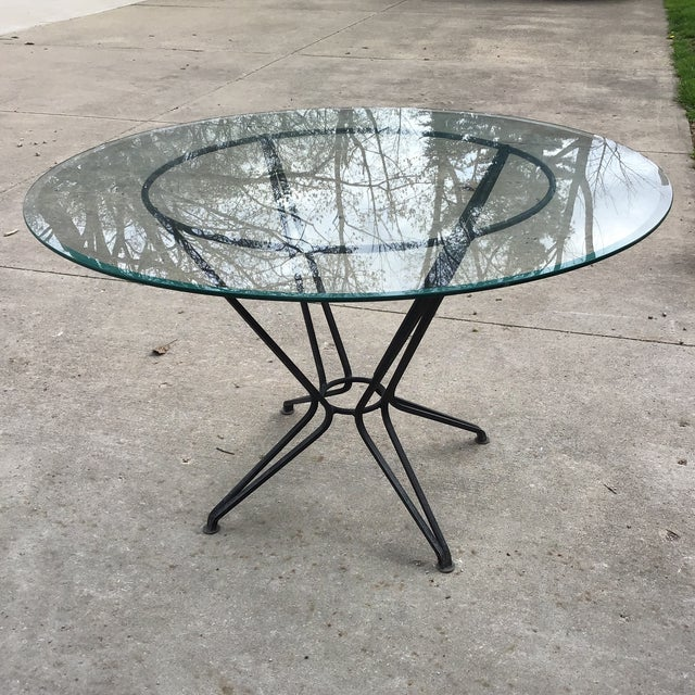 Original Salterini dining or patio wrought iron table with 48 inch glass table removable top, which is larger size glass....