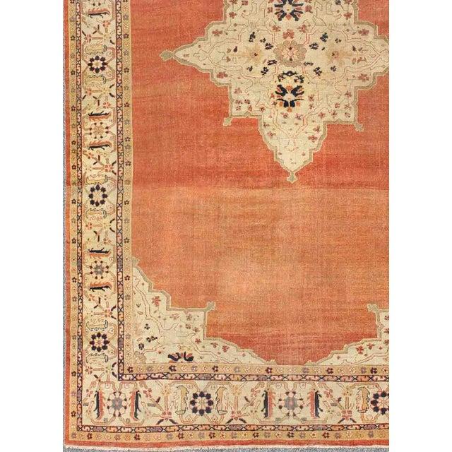 Antique Ziegler Sultanabad Rug in Soft Orange, Ivory and pop of Navy Blue. This striking antique Ziegler Sultanabad carpet...