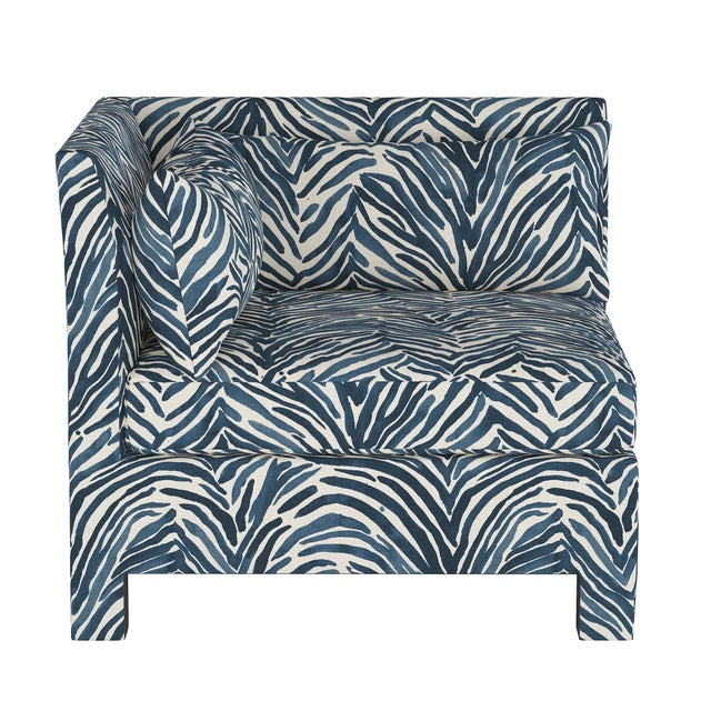 This sleek and fully upholstered corner accent chair can be combined with complementary ottoman and armless modular pieces...